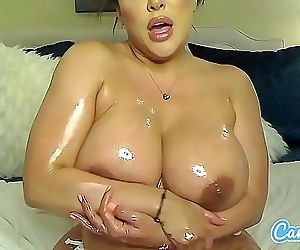 Kiara Mia oils her big..