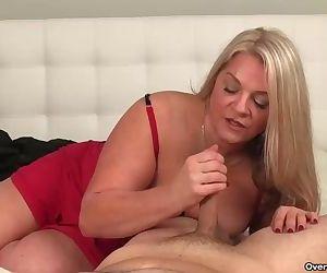 Huge-titted blonde milf..
