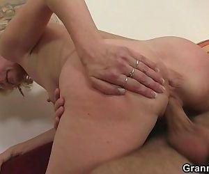 Blonde granny jumps on..