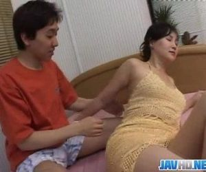 Asian milf gets down..