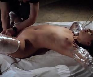 Rough bondage slapping..