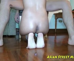 Asian Woman Dribbles..