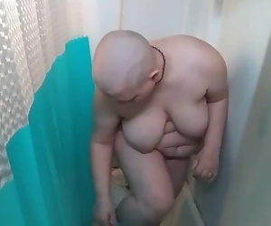 Bald girl in the shower..