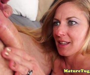 Cougar milf tugs cock..