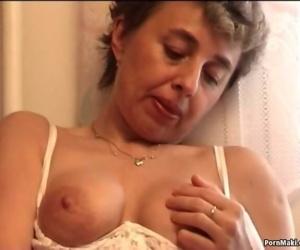 Granny masturbates with..