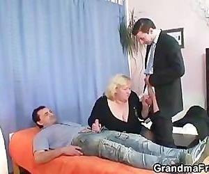Granny takes two cocks..